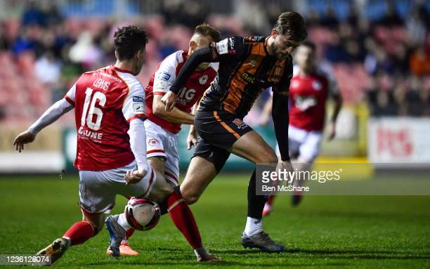 Dublin , Ireland - 25 October 2021; Will Patching of Dundalk is tackled by Alfie Lewis, left, and Jamie Lennon of St Patrick's Athletic during the...