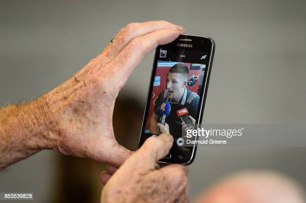 Dublin , Ireland - 25 September 2017; A reporter takes a picture of Andrew Conway of Munster during a Munster Rugby Press Conference at the...