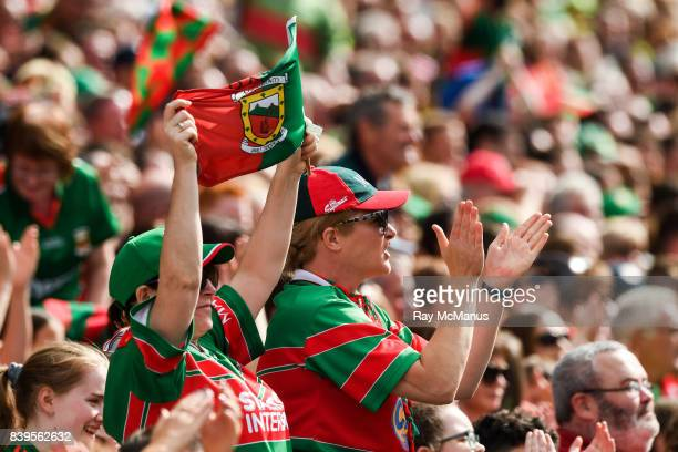 Dublin Ireland 26 August 2017 Mayo fans in the Cusack Stand celebrate a score during the GAA Football AllIreland Senior Championship SemiFinal Replay...