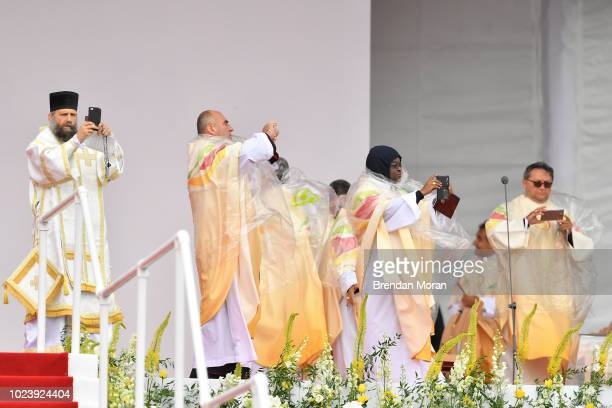 Dublin Ireland 26 August 2018 Members of the clergy take pictures with their smart phones during the closing mass of Pope Francis's Ireland visit at...