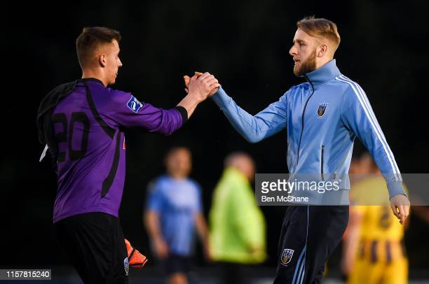 Dublin Ireland 26 July 2019 Suspended UCD goalkeeper Conor Kearns right consoles Tom Murphy of UCD following the SSE Airtricity League Premier...