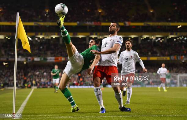 Dublin Ireland 26 March 2019 Robbie Brady of Republic of Ireland in action against Davit Khocholava of Georgia during the UEFA EURO2020 Group D...