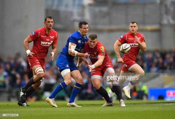 Dublin Ireland 26 May 2018 Jonathan Sexton of Leinster is tackled by Scott Williams of Scarlets during the Guinness PRO14 Final between Leinster and...