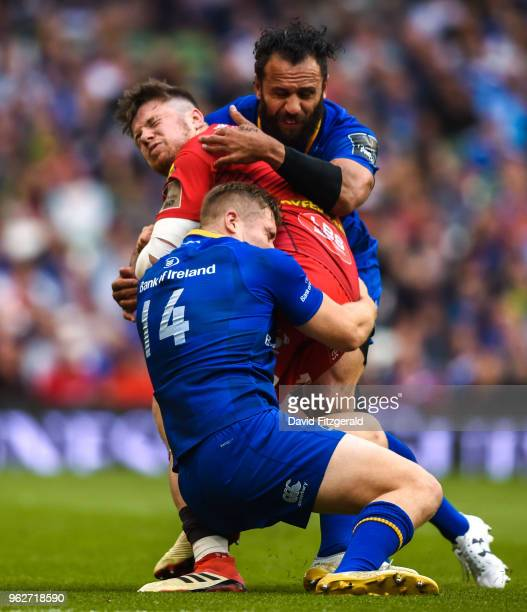 Dublin Ireland 26 May 2018 Steff Evans of Scarlets is tackled by Jordan Larmour and Isa Nacewa of Leinster during the Guinness PRO14 Final between...
