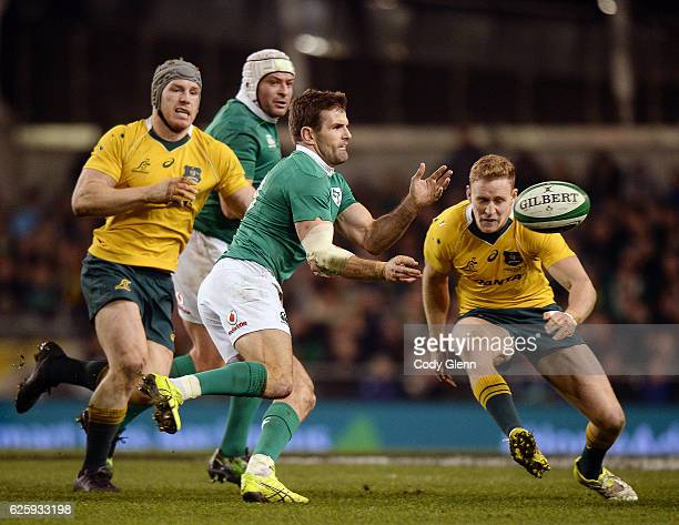 Dublin Ireland 26 November 2016 Jared Payne of Ireland in action against David Pocock left and Reece Hodge of Australia during the Autumn...