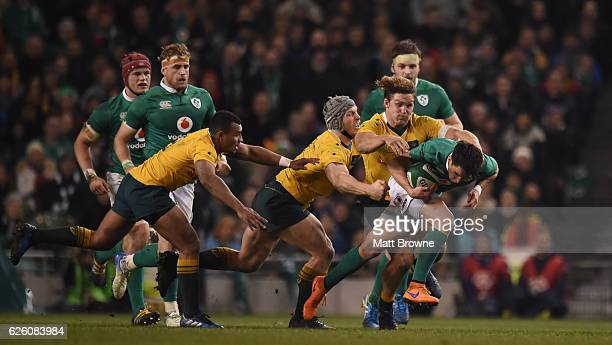 Dublin Ireland 26 November 2016 Joey Carbery of Ireland in action against Will Genia Dean Mumm and Michael Hooper of Australia during the Autumn...