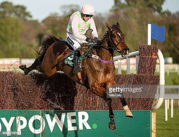 Dublin Ireland 27 December 2016 Douvan with Ruby Walsh up jumps the last on their way to winning the Paddy Power Cashcard Steeplechase during day two...
