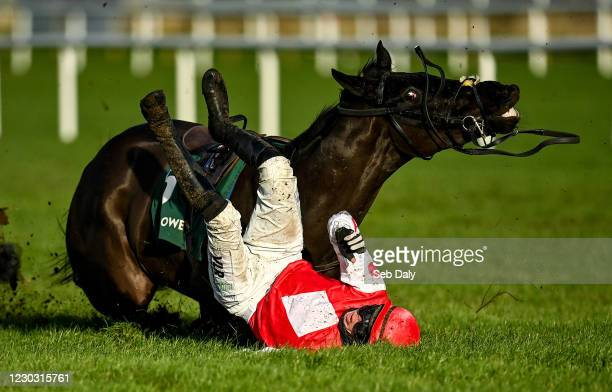 Dublin , Ireland - 27 December 2020; Jungle Junction and jockey Paddy Kennedy fall at the last during the Paddy Power Games 'Don't Think You're...
