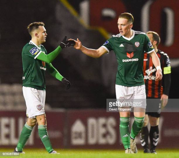 Dublin Ireland 27 February 2018 Ronan Curtis of Derry City right is congratulated by teammate Rory Hale after scoring his side's first goal during...