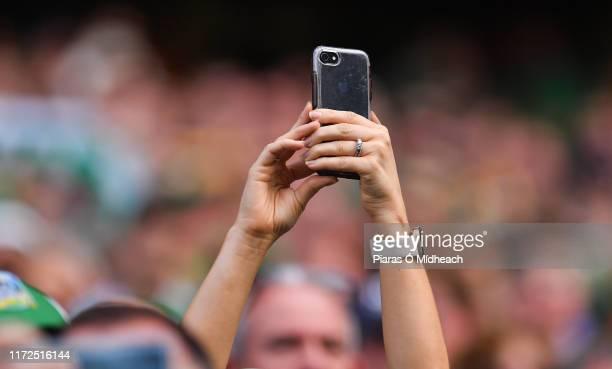 Dublin Ireland 27 July 2019 A spectator takes a photograph during the GAA Hurling AllIreland Senior Championship SemiFinal match between Kilkenny and...
