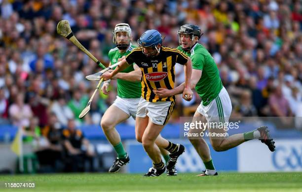 Dublin Ireland 27 July 2019 John Donnelly of Kilkenny in action against Cian Lynch left and Declan Hannon of Limerick during the GAA Hurling...