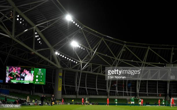 Dublin , Ireland - 27 March 2021; A message of support shown on the big screen for former Republic of Ireland footballer Alan McLoughlin, who is...