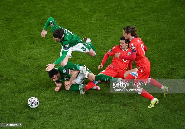 Dublin , Ireland - 27 March 2021; Alan Browne and Enda Stevens of Republic of Ireland in action against Olivier Thill and Vincent Thill, right, of...