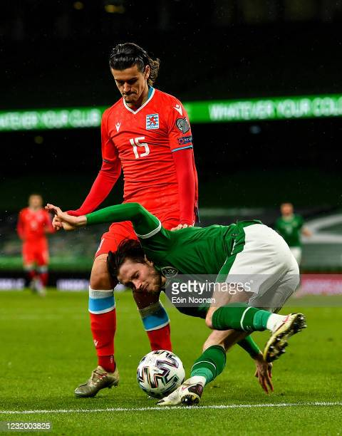 Dublin , Ireland - 27 March 2021; Alan Browne of Republic of Ireland in action against Olivier Thill of Luxembourg during the FIFA World Cup 2022...