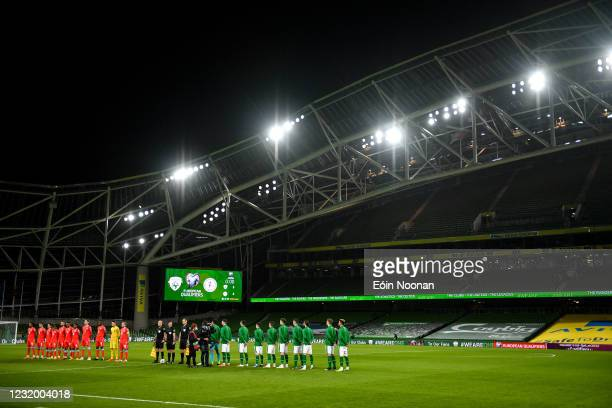Dublin , Ireland - 27 March 2021; Both teams stand for the playing of Amhrán na bhFiann prior to the FIFA World Cup 2022 qualifying group A match...
