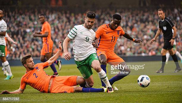 Dublin Ireland 27 May 2016 Shane Long of Republic of Ireland in action against Joel Veltman left and Quincy Promes of Netherlands during the 3...