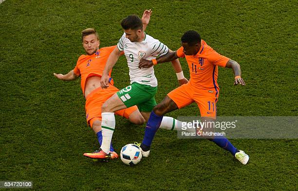Dublin Ireland 27 May 2016 Shane Long of Republic of Ireland in action against Quincy Promes right and Joel Veltman of Netherlands during the 3...