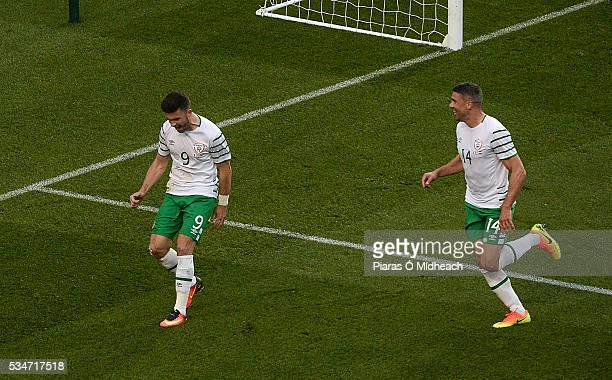 Dublin Ireland 27 May 2016 Shane Long of Republic of Ireland celebrates scoring his side's first goal with teammate Jonathan Walters right during the...