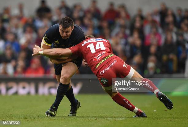 Dublin Ireland 27 May 2017 Niall Scannell of Munster is tackled by Liam Williams of Scarlets during the Guinness PRO12 Final between Munster and...