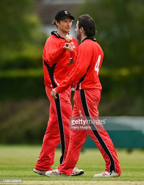 Dublin , Ireland - 27 May 2021; Matt Ford, left, and Tyrone Kane of Munster Reds celebrate the wicket of Ben White of Northern Knights during the...