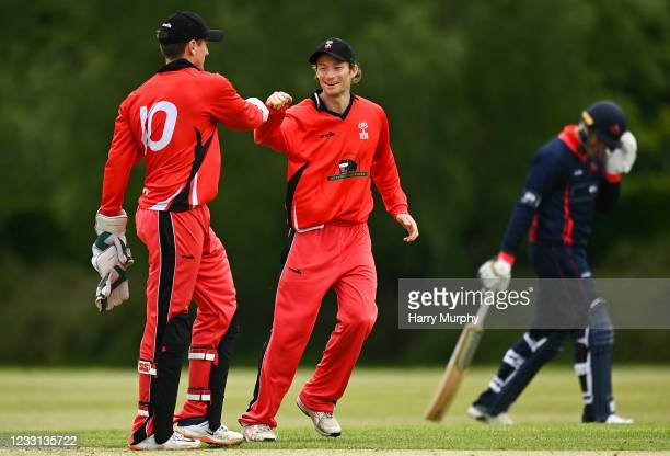 Dublin , Ireland - 27 May 2021; PJ Moor, left, and Matt Ford of Munster Reds celebrate the wicket of Ben White of Northern Knights during the Cricket...