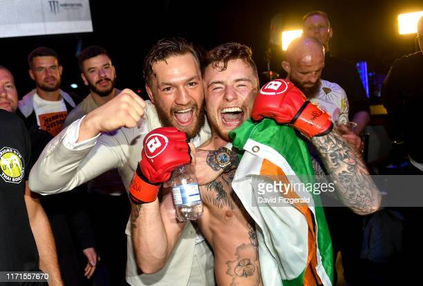 Dublin , Ireland - 27 September 2019; James Gallagher celebrates with team-mate Conor McGregor after defeating Roman Salazar in their contract weight...