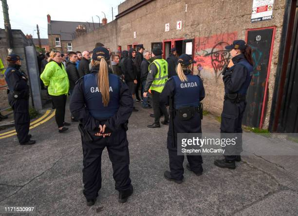 Dublin Ireland 27 September 2019 Members of An Garda Síochána watch on as Shamrock Rovers supporters enter Dalymount Park prior to the Extraie FAI...