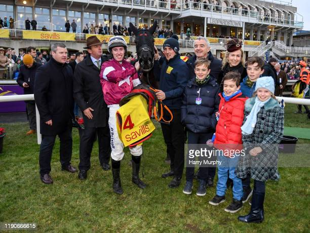 Dublin Ireland 28 December 2019 Jockey Jack Kennedy trainer Gordon Eliott owers Michael and Eddie O'Leary after sending out Delta Work to win the...