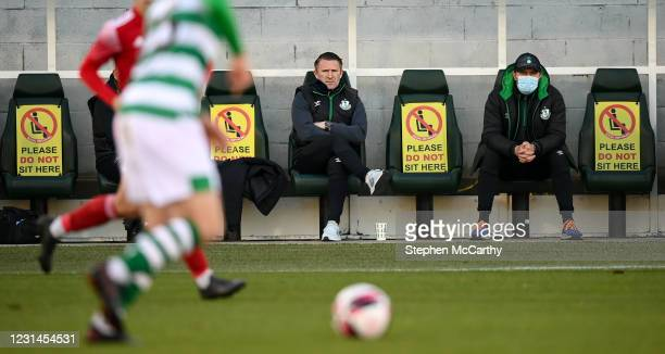 Dublin , Ireland - 28 February 2021; Shamrock Rovers sporting director Stephen McPhail, right, and Robbie Keane watch on during the pre-season...