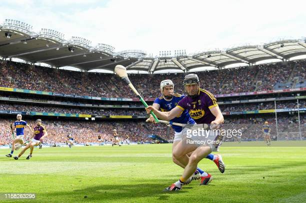 Dublin , Ireland - 28 July 2019; Diarmuid O'Keeffe of Wexford in action against Brendan Maher of Tipperary during the GAA Hurling All-Ireland Senior...