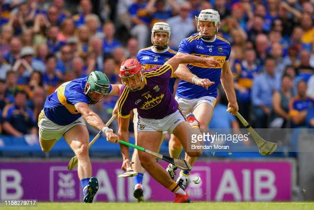 Dublin , Ireland - 28 July 2019; Lee Chin of Wexford is dispossessed by Cathal Barrett of Tipperary during the GAA Hurling All-Ireland Senior...