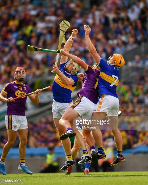 Dublin , Ireland - 28 July 2019; Ronan Maher of Tipperary wins possession ahead of his team mate Padraic Maher and Conor McDonald of Wexford during...