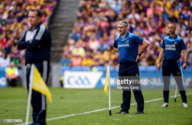 Dublin Ireland 28 July 2019 Tipperary manager Liam Sheedy centre Tipperary selector Tommy Dunne right and Wexford manager Davy Fitzgerald during the...