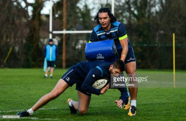 Dublin Ireland 28 November 2017 James Lowe above and Ross Byrne during Leinster rugby squad training at UCD in Dublin