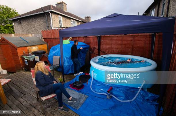 Dublin Ireland 29 April 2020 Swimmer Mia WhelanO'Connor of ESB Swimming Club swims in her back garden in an inflatable pool in Inchicore Dublin using...