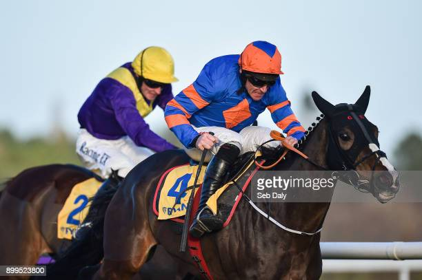 Dublin Ireland 29 December 2017 Mick Jazz right with Davy Russell up races ahead of Cilaos Emery with David Mullins up on their way to winning the...