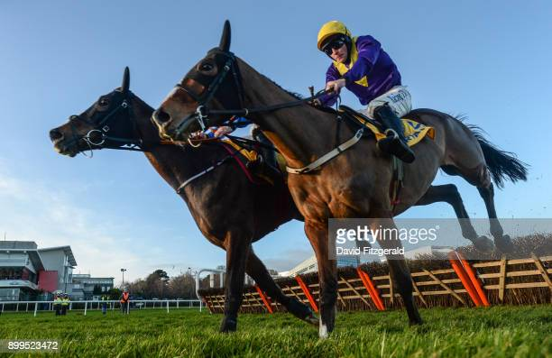 Dublin Ireland 29 December 2017 Mick Jazz with Davy Russell up left jumps the last ahead of Cilaos Emery with David Mullins up on their way to...