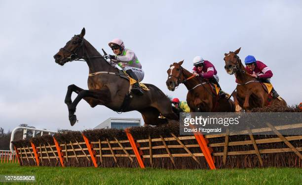 Dublin Ireland 29 December 2018 Sharjah with Patrick Mullins up left jump the last ahead of Samcro with Jack Kennedy up centre and Tombstone with...