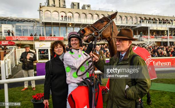 Dublin Ireland 29 December 2019 Patrick Mullins with Sharjah his father and trainer Willie Mullins and mother Jackie after winning the Matheson...