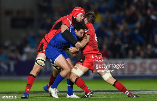 Dublin Ireland 29 September 2017 Joey Carbery of Leinster is tackled by Grant Gilchrist left and Darryl Marfo of Edinburgh during the Guinness PRO14...