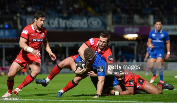 Dublin Ireland 29 September 2017 Sean Cronin of Leinster is tackled by Jason Tovey left and Darryl Marfo of Edinburgh during the Guinness PRO14 Round...