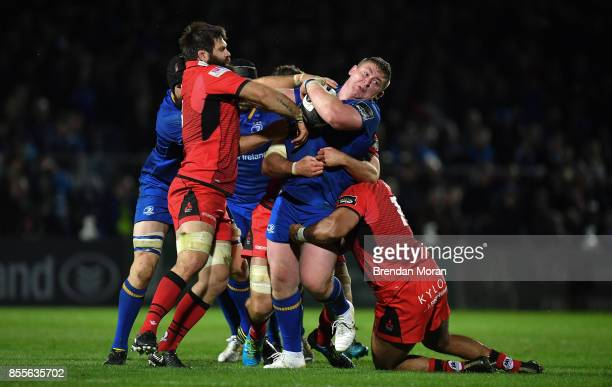 Dublin Ireland 29 September 2017 Tadhg Furlong of Leinster is tackled by Cornell du Preez left and Darryl Marfo of Edinburgh during the Guinness...
