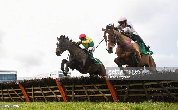 Dublin Ireland 3 February 2018 Supasundae with Robbie Power up left jump the last ahead of Faugheen with Paul Townend up on their way to winning the...