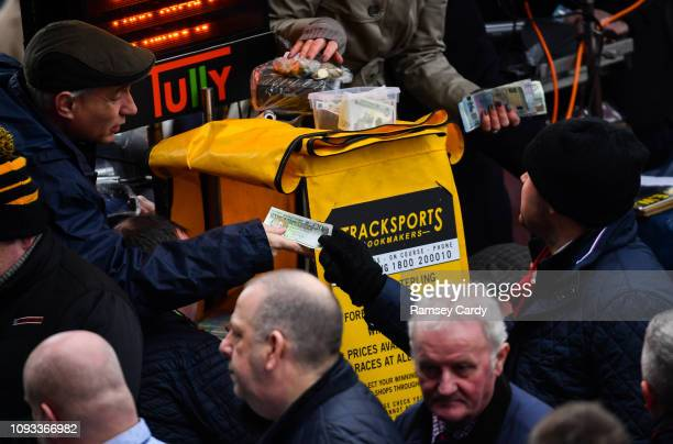 Dublin Ireland 3 February 2019 A racegoer places a bet ahead of the Unibet Irish Gold Cup during Day Two of the Dublin Racing Festival at...