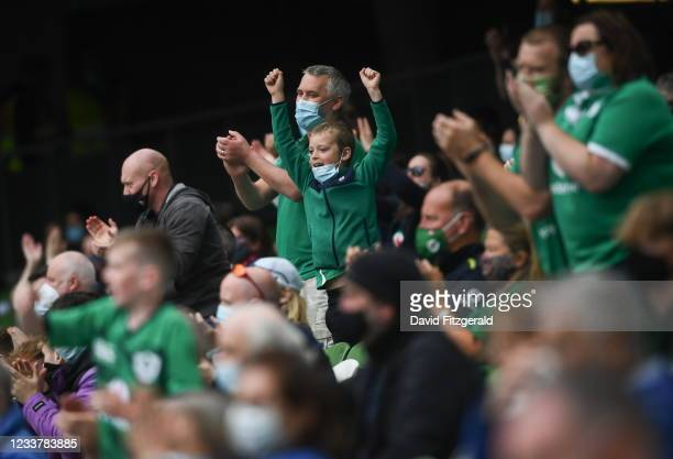 Dublin , Ireland - 3 July 2021; Ireland supporters celebrate their side's fifth try scored by Jacob Stockdale during the International Rugby Friendly...