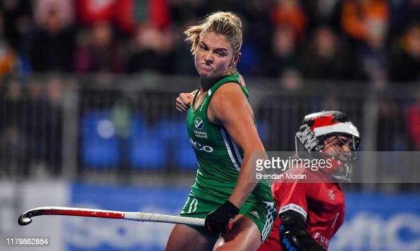 Dublin Ireland 3 November 2019 Chloe Watkins of Ireland celebrates after scoring penalty stroke during the FIH Women's Olympic Qualifier match...