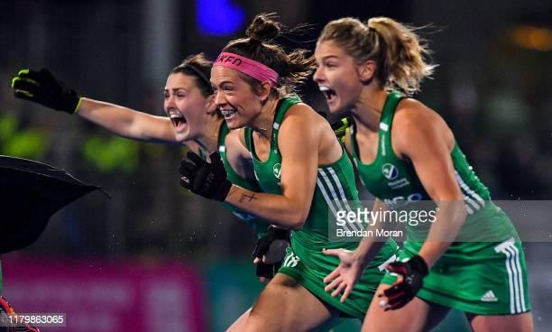 Dublin Ireland 3 November 2019 Ireland players from left Roisin Upton Bethany Barr and Chloe Watkins celebrate winning the penalty strokes and...