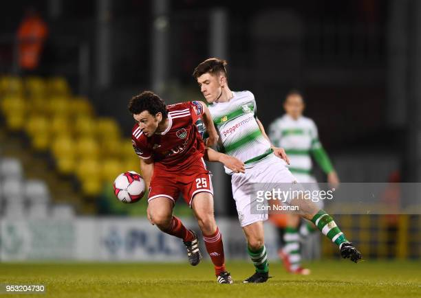 Dublin Ireland 30 April 2018 Barry McNamee of Cork City in action against Aaron Bolger of Shamrock Rovers during the SSE Airtricity League Premier...