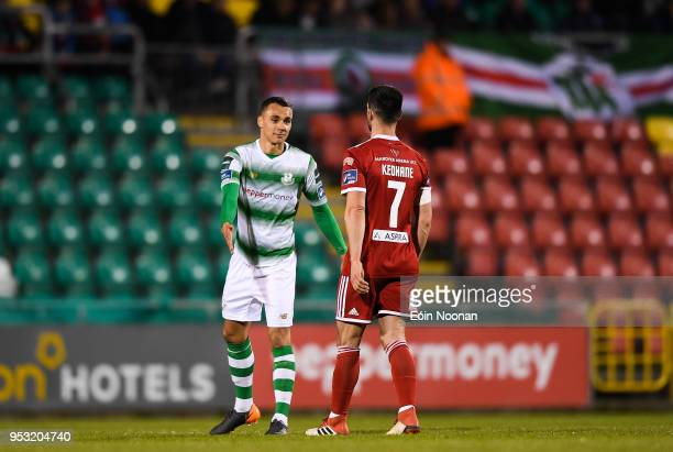 Dublin Ireland 30 April 2018 Graham Burke of Shamrock Rovers with Jimmy Keohane of Cork City as he makes his way off the pitch during the SSE...
