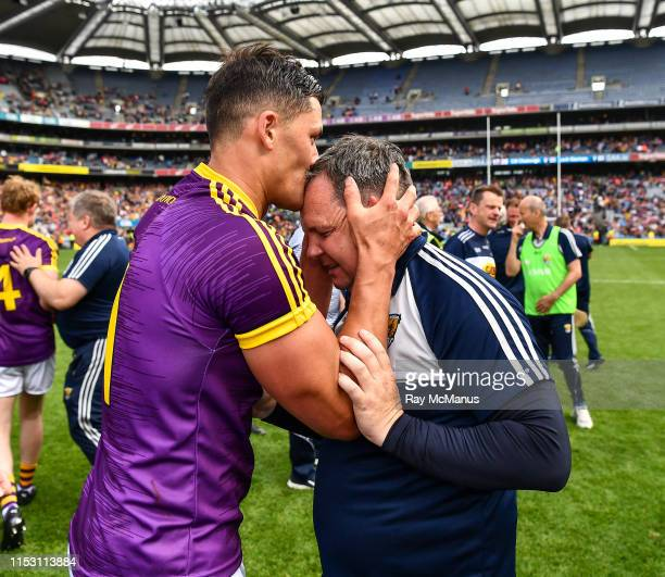 Dublin , Ireland - 30 June 2019; Wexford manager Davy Fitzgerald is kissed by Lee Chin after the Leinster GAA Hurling Senior Championship Final match...